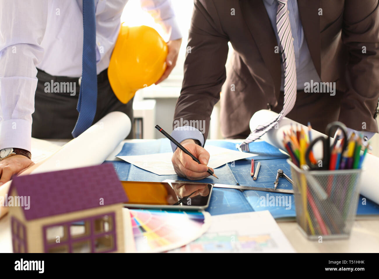Architect Engineer Team Work on Building Draft - Stock Image