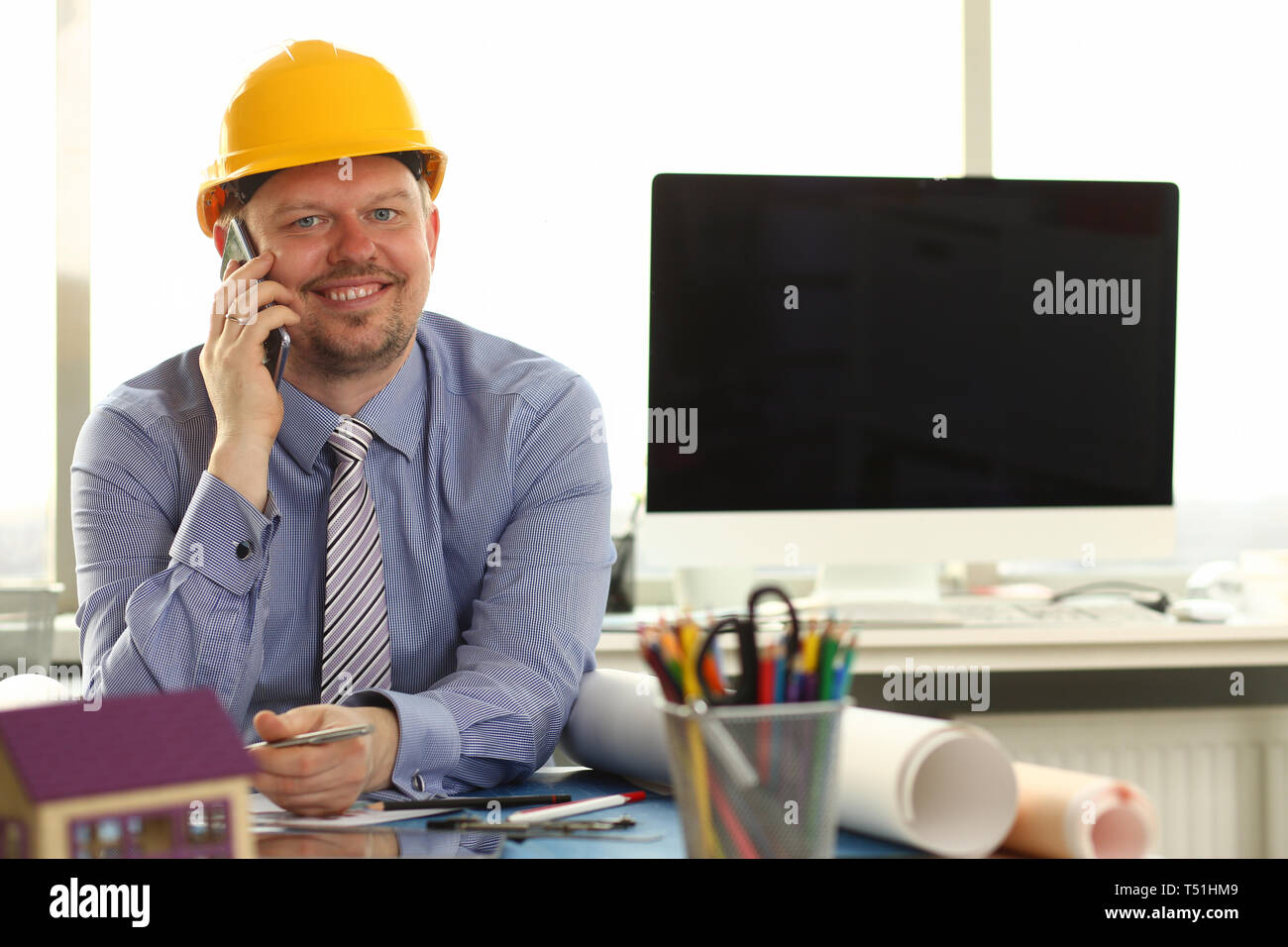 Foreman Sketching Architect Blueprint Making Deal - Stock Image