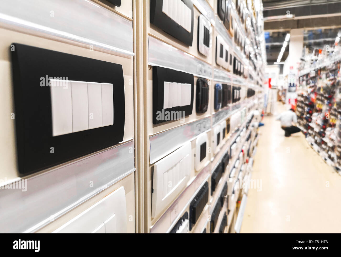 home improvement center storehouse aisle with light switches and sockets  plate covers in hardware store - Stock Image