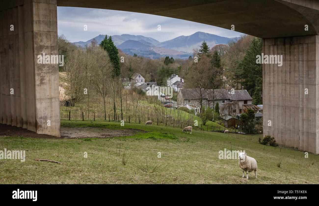 A66 Keswick bypass bridge framing the Lake District landscape. Stock Photo
