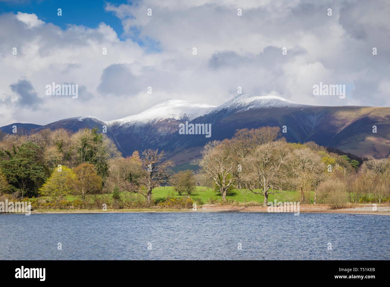 Derwentwater in spring with snow on Skiddaw, Cumbria, UK. Stock Photo