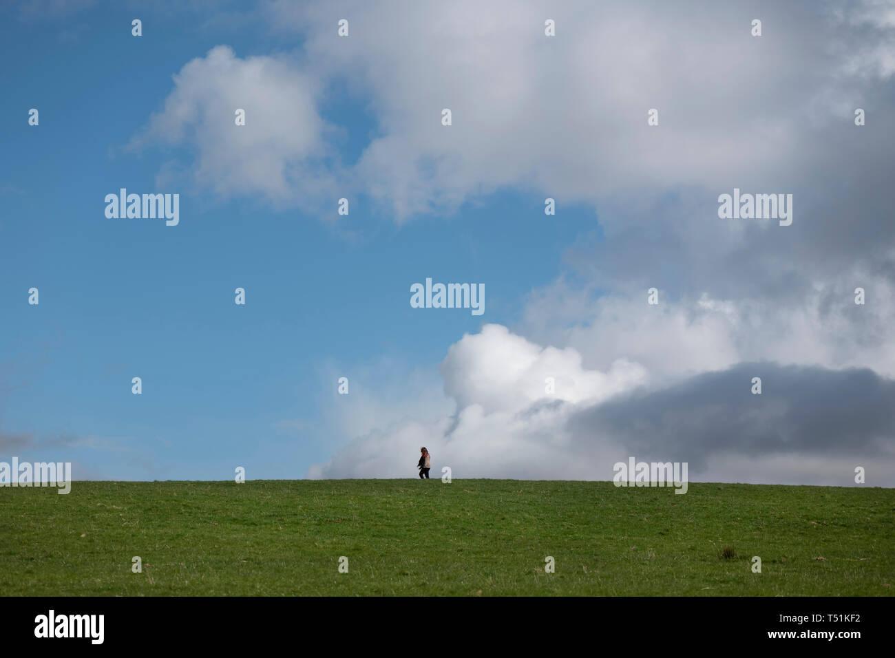 A lone woman walks through Crow Park, Keswick, Lake District, UK. Stock Photo