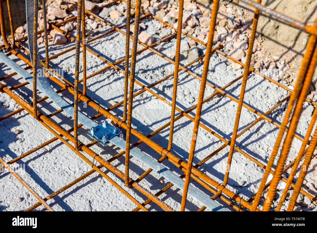 Under construction lightning conductor system as a part of basic metal profile made of bended and tied reinforcing rod for industrial building. - Stock Image