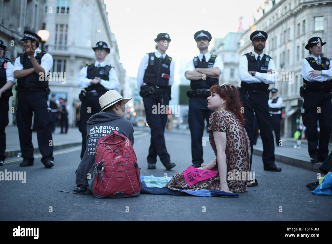 Police with Extinction Rebellion demonstrators at Oxford Circus in London. Stock Photo