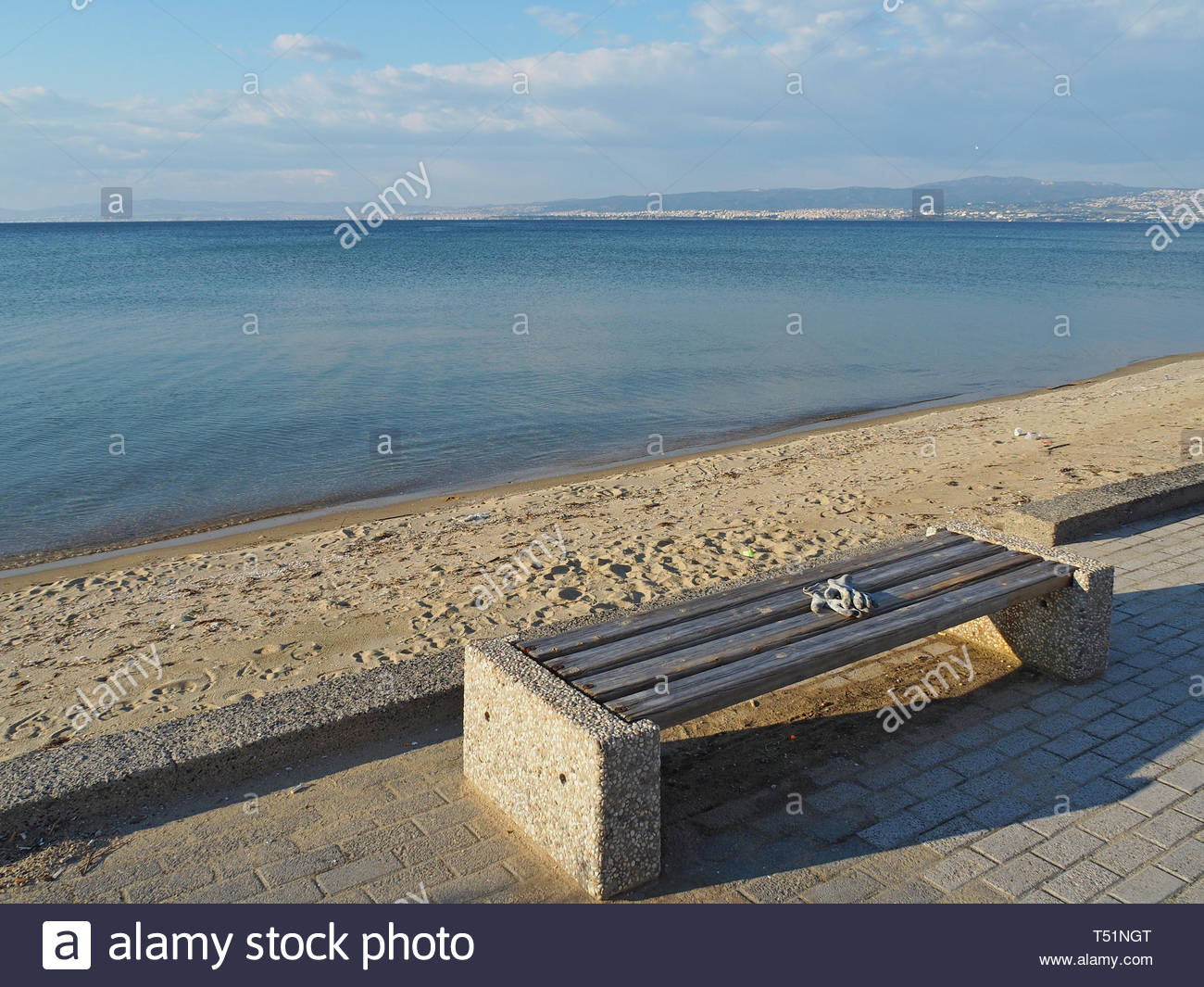 a pair of protective gloves on a bench - Stock Image
