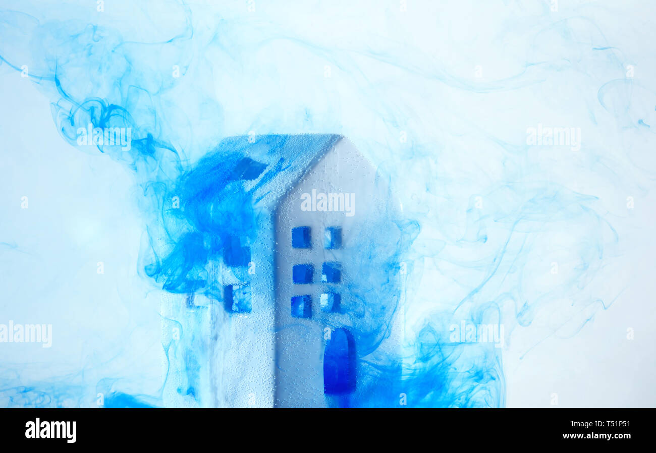 Small Ceramic House Under The Water With Blue Acrylic Paints The
