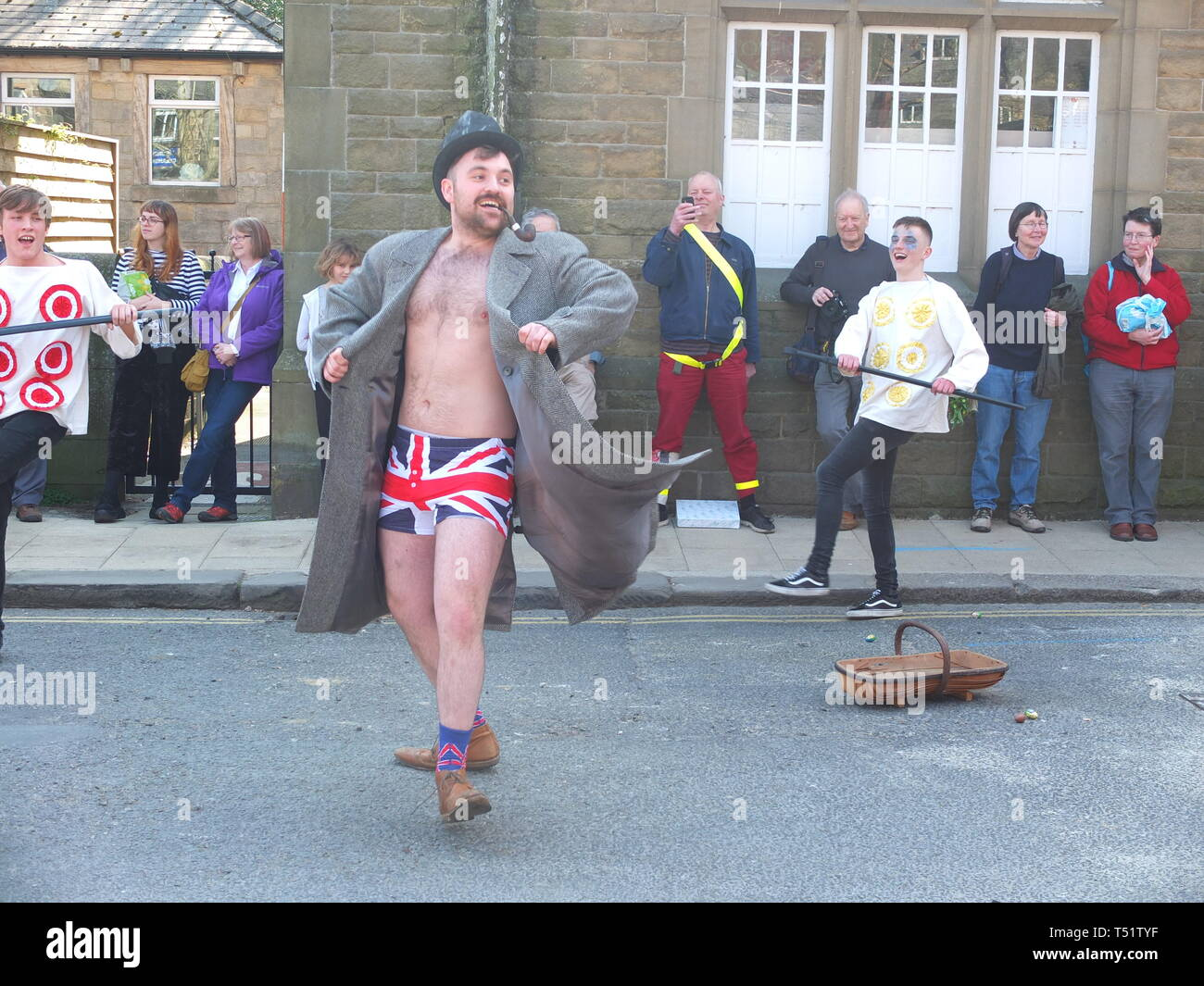 'Tosspot' character in the Midgley Pace Egg Play traditional mummers play at Hebden Bridge flashing Union Jack boxer shorts Stock Photo