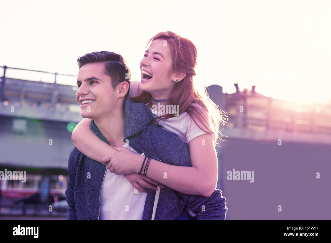 Happy laughing couple being extremely close to each other - Stock Image