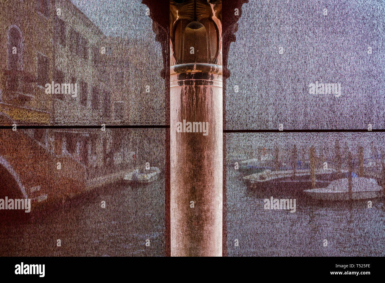 The view of the Grand Canal through screens divided by a column in the Venice Fish Market, Italy. - Stock Image