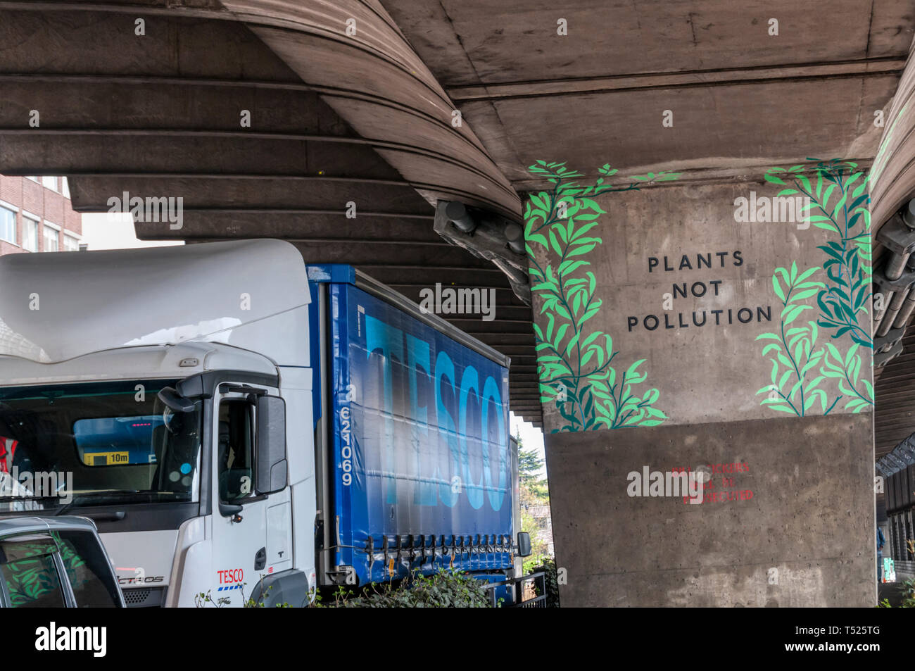 Plants not Pollution artwork under Hammersmith Flyover next to the busy Talgarth Road is part of Hammersmith Business Low Emission Neighbourhood. - Stock Image