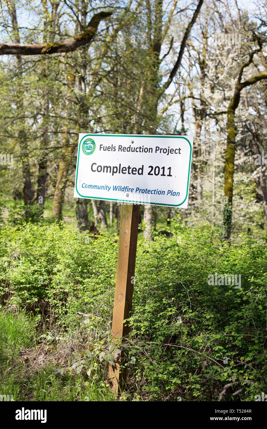 A sign for the Fuels Reduction Project, at the Oregon Garden in Silverton, Oregon, USA. - Stock Image