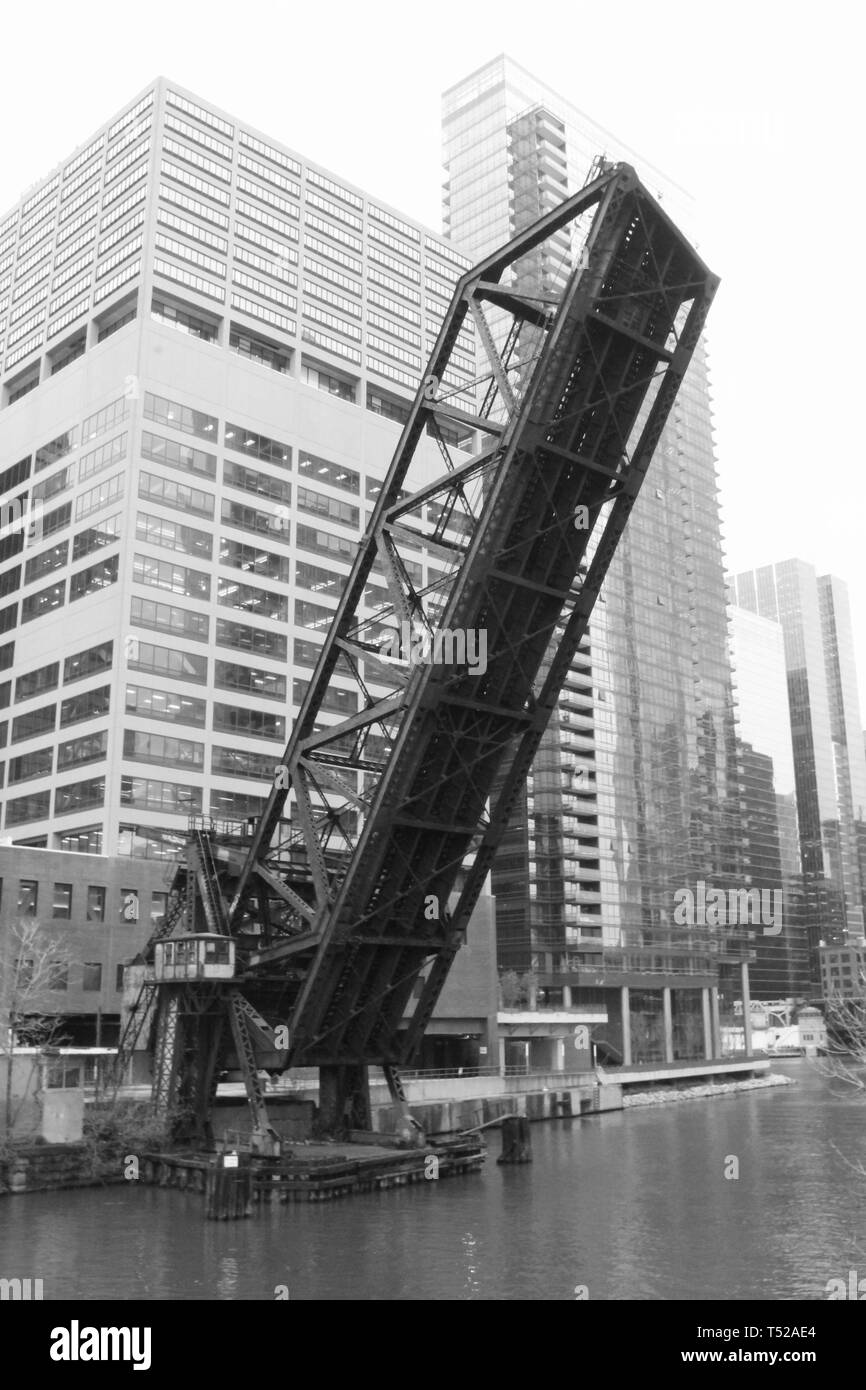The abandoned Carroll Avenue Railroad bridge permanently locked in a raised position over the Chicago River near Wolf Point and the Apparel Mart - Stock Image