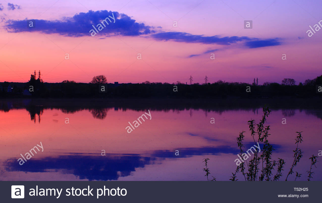 Amazing reflection of colorful sky and clouds in the water - Stock Image