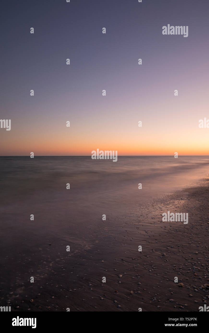 twilight afterglow over sky and water at dusk - Stock Image