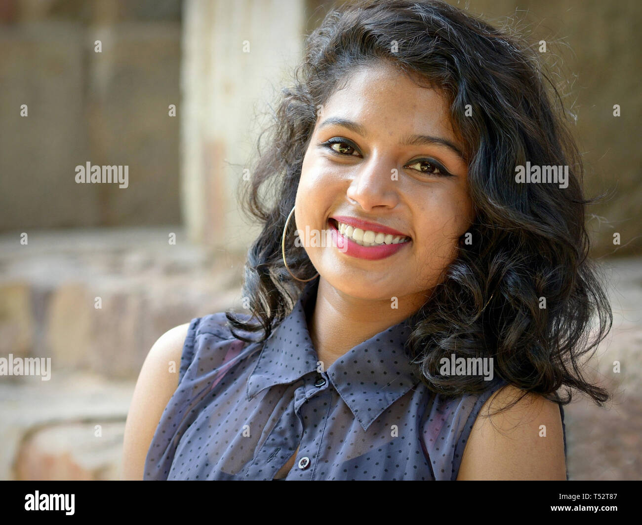Attractive young Indian woman with hoop earrings and