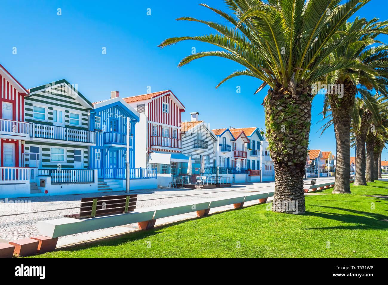 Costa Nova, Portugal: colorful striped houses called Palheiros with red, blue and green stripes. Costa Nova do Prado is a beach village resort on Atla Stock Photo