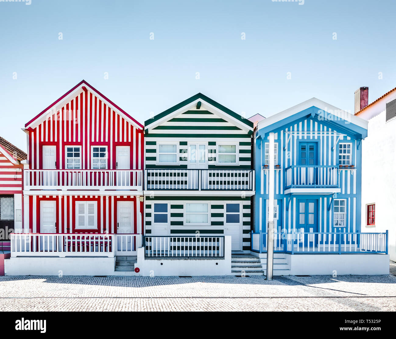 Costa Nova, Portugal: colorful striped houses called Palheiros with red, blue and green stripes. Costa Nova do Prado is a beach village resort on Atla Stock Photo