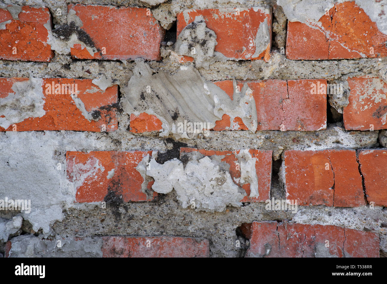 The brickwork of the fireplace in an old house built in the middle of the last century. Background. - Stock Image
