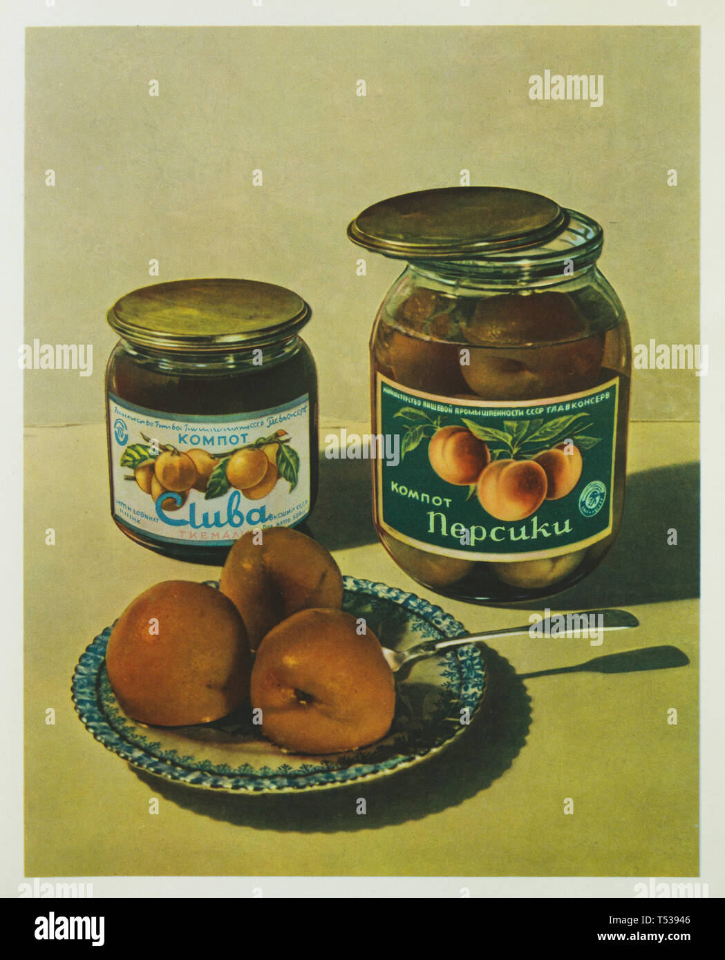 Soviet canned cherry plum kompot and canned peach kompot depicted in the colour illustration in the Book of Tasty and Healthy Food published in the Soviet Union (1953). Stock Photo