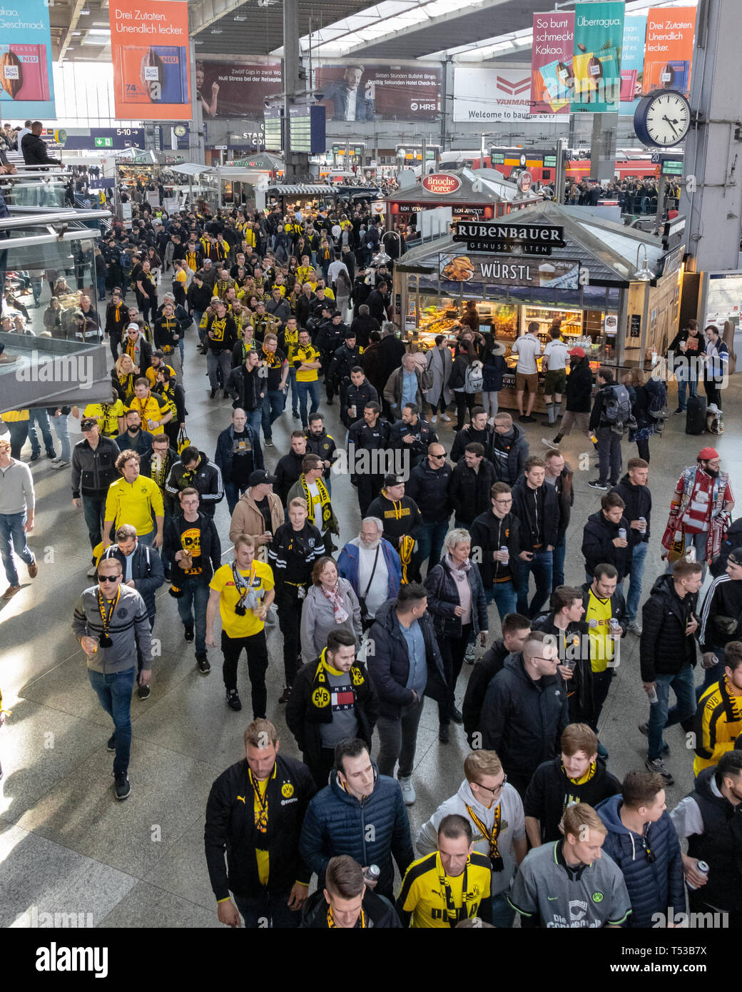CENTRAL STATIONS, MUNICH, APRIL 6, 2019: bvb fans on the way to the soccer game fc bayern munich vs borussia dortmund Stock Photo