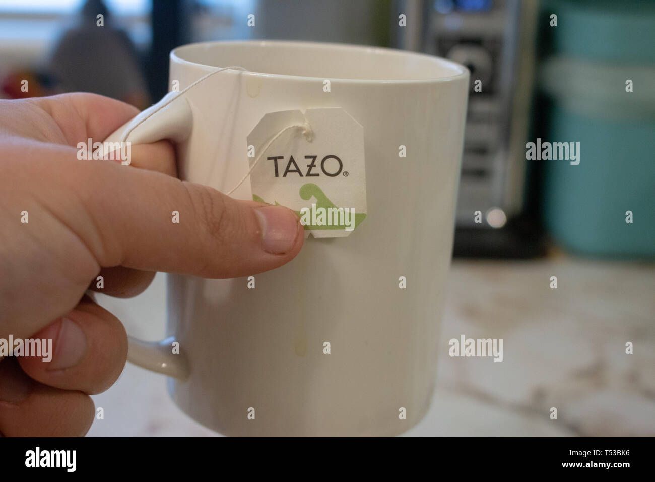 London Canada, April 20 2019: Editorial illustrative photo of a mug with a tazo tea bag in it. Tazo is a former starbucks branded tea now owned by - Stock Image
