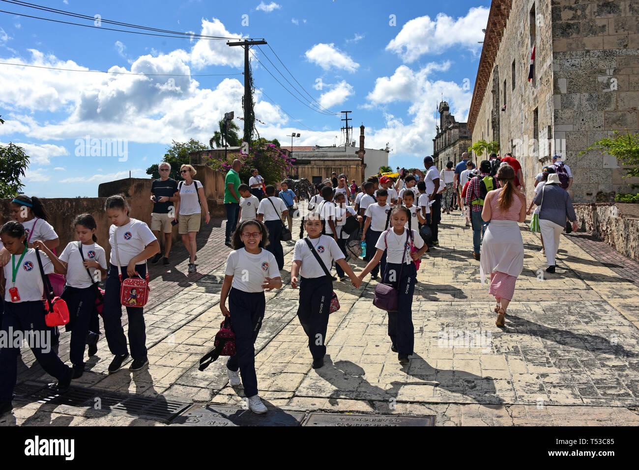 Santo Domingo, Dominican Republic - February 7, 2019:  A group of Dominican school children in uniform in the historic Colonial Zone of Santo Domingo  - Stock Image