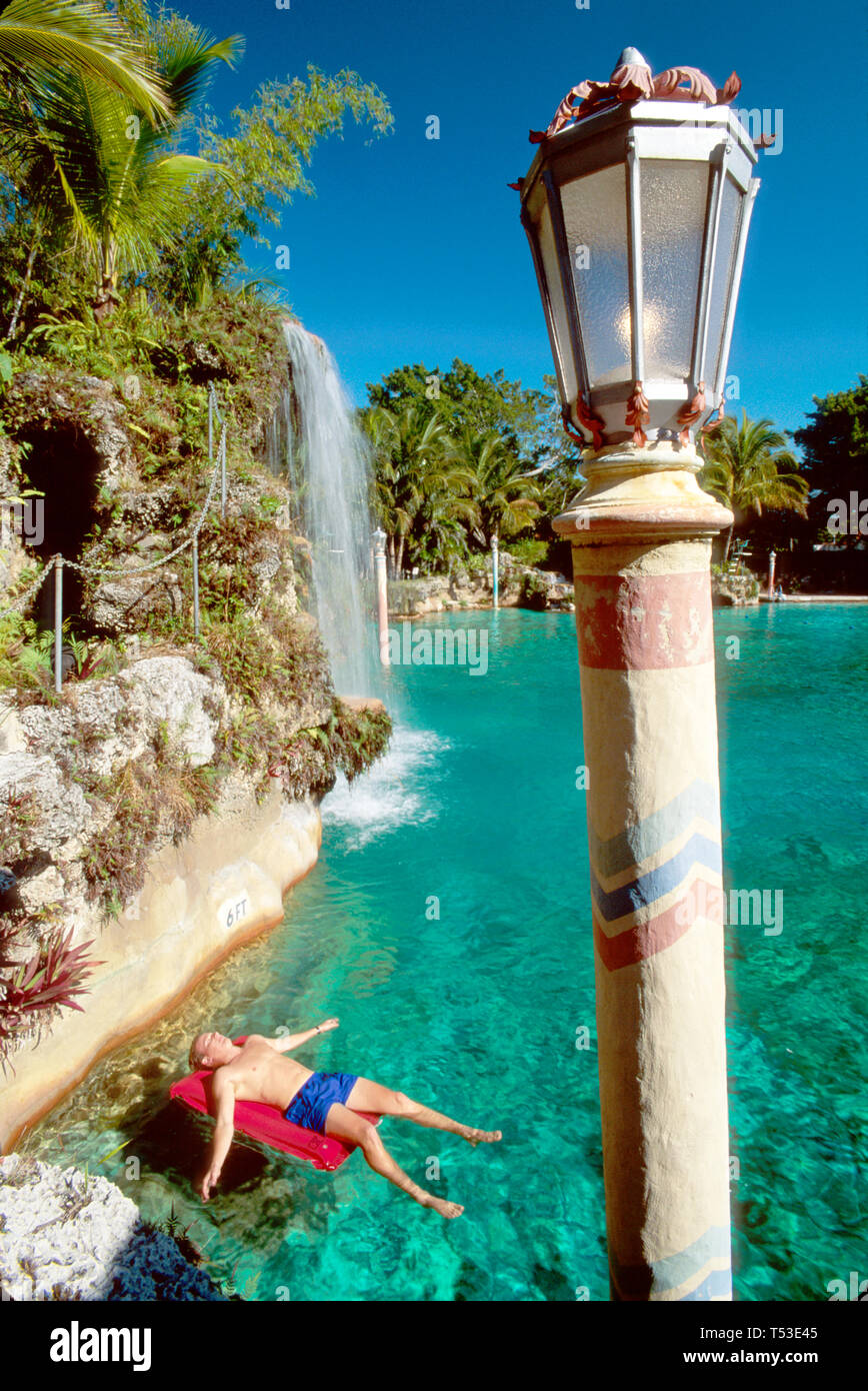 Coral Gables Miami Florida Venetian Pool Spanish Mediterranean style light staff former quarry visitor waterfall - Stock Image