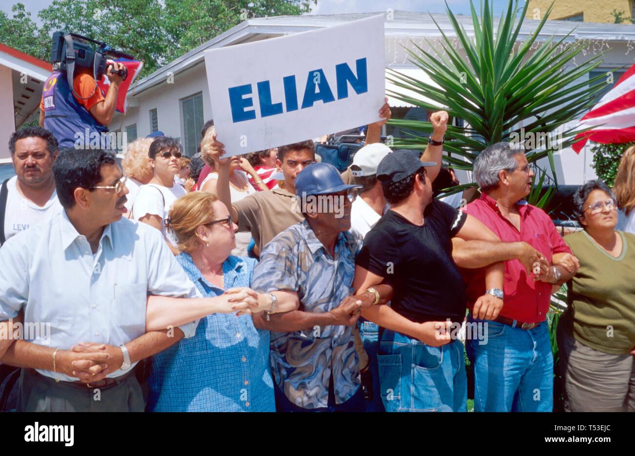 Miami Florida Little Havana Cuban refuges form human chain around Elian Gonzalez home protesting Castro government Stock Photo