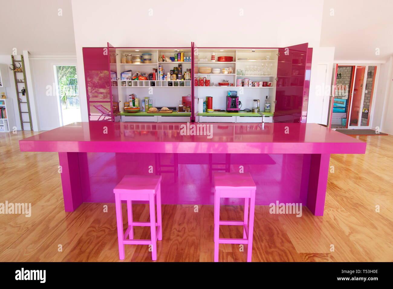 Magenta pink orange kitchen - Stock Image