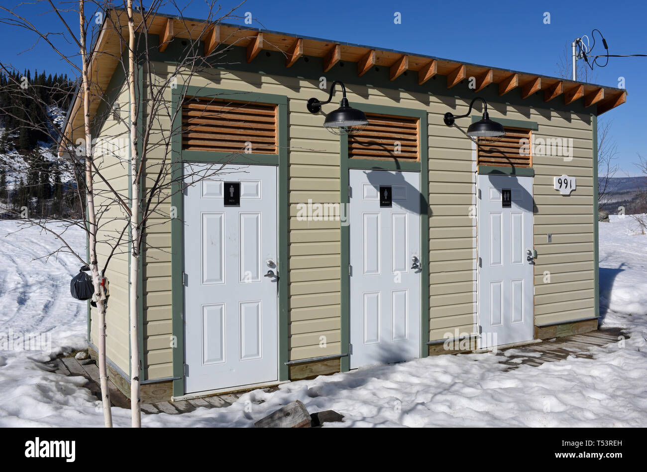 Cosy rest-rooms for men, women and couples in the historic gold-mining town of Dawson City, Yukon, Canada - Stock Image