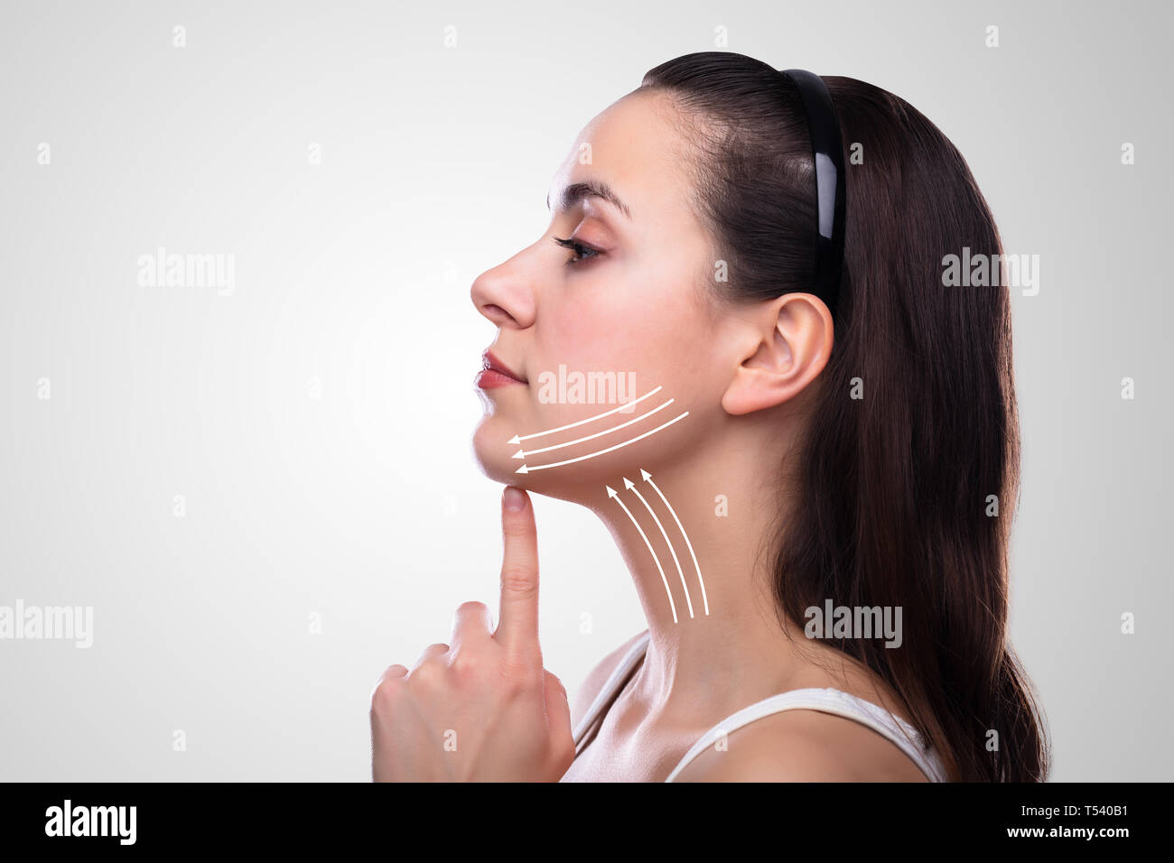 Woman With Arrows On Her Face Over White Background Stock Photo