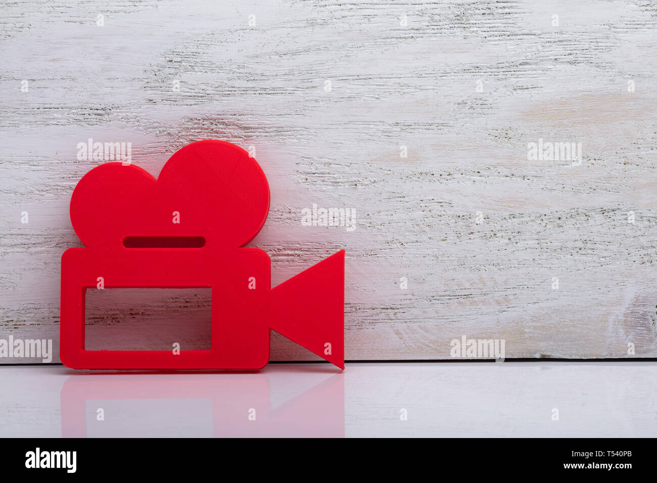 Close-up Of Red Video Camera Sign Over White Desk - Stock Image