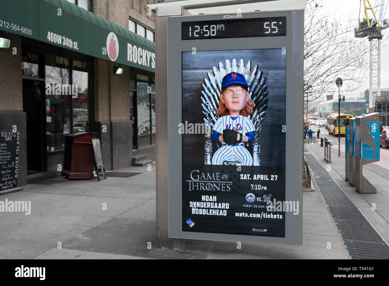 An advertisement for the Game of Thrones & Noah Syndergard bobblehead night. On a sheltered bus top on West 34th St. in Manhattan, New York City. Stock Photo
