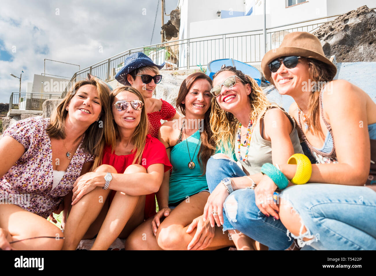 Group of cheerful and happy young women friends enjoy the day during summer vacation together in friendship - people have fun and laugh - beautiful la Stock Photo