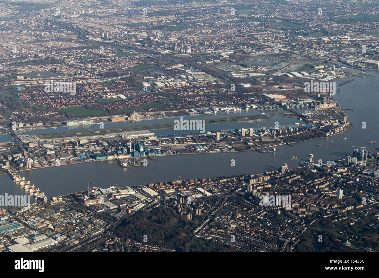 Aerial view of London City airport from the south - Stock Image