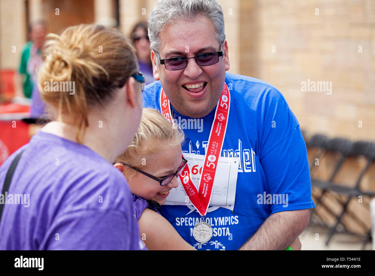Special Olympics for developmentally delayed members event at St. Thomas University laughing and received an award. St Paul Minnesota MN USA - Stock Image