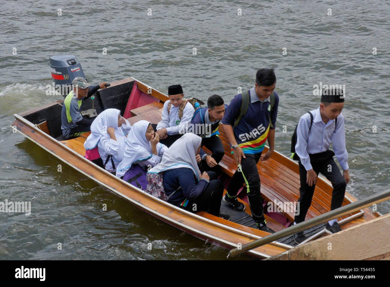 Water taxi carrying Muslim students on Brunei River, Bandar Seri Begawan, Sultanate of Brunei - Stock Image