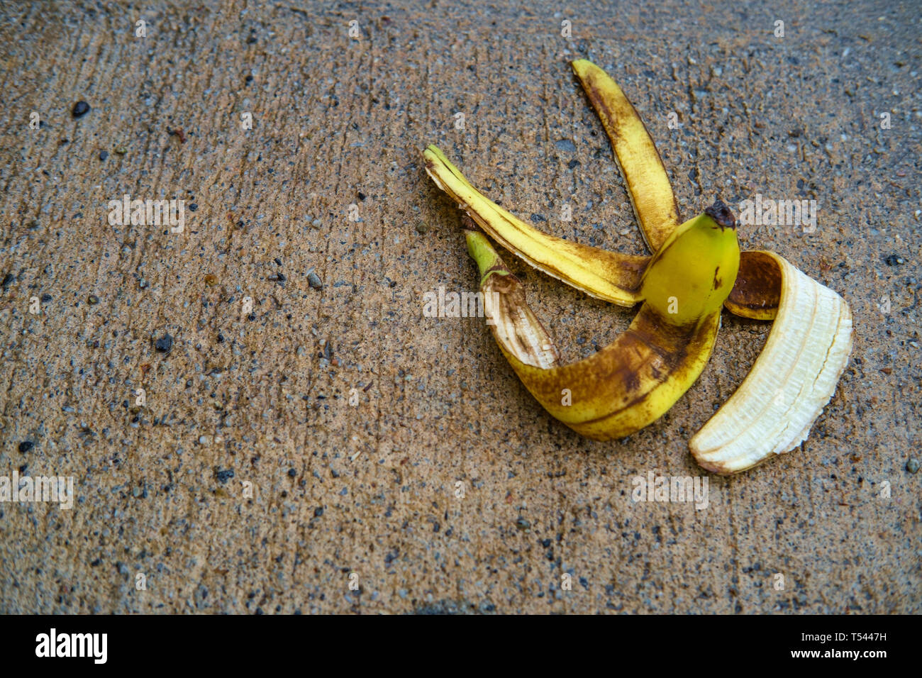 e001df1c4744f Slapstick slippery comedy banana peel laying on ground ready to make  someone slip and fall -