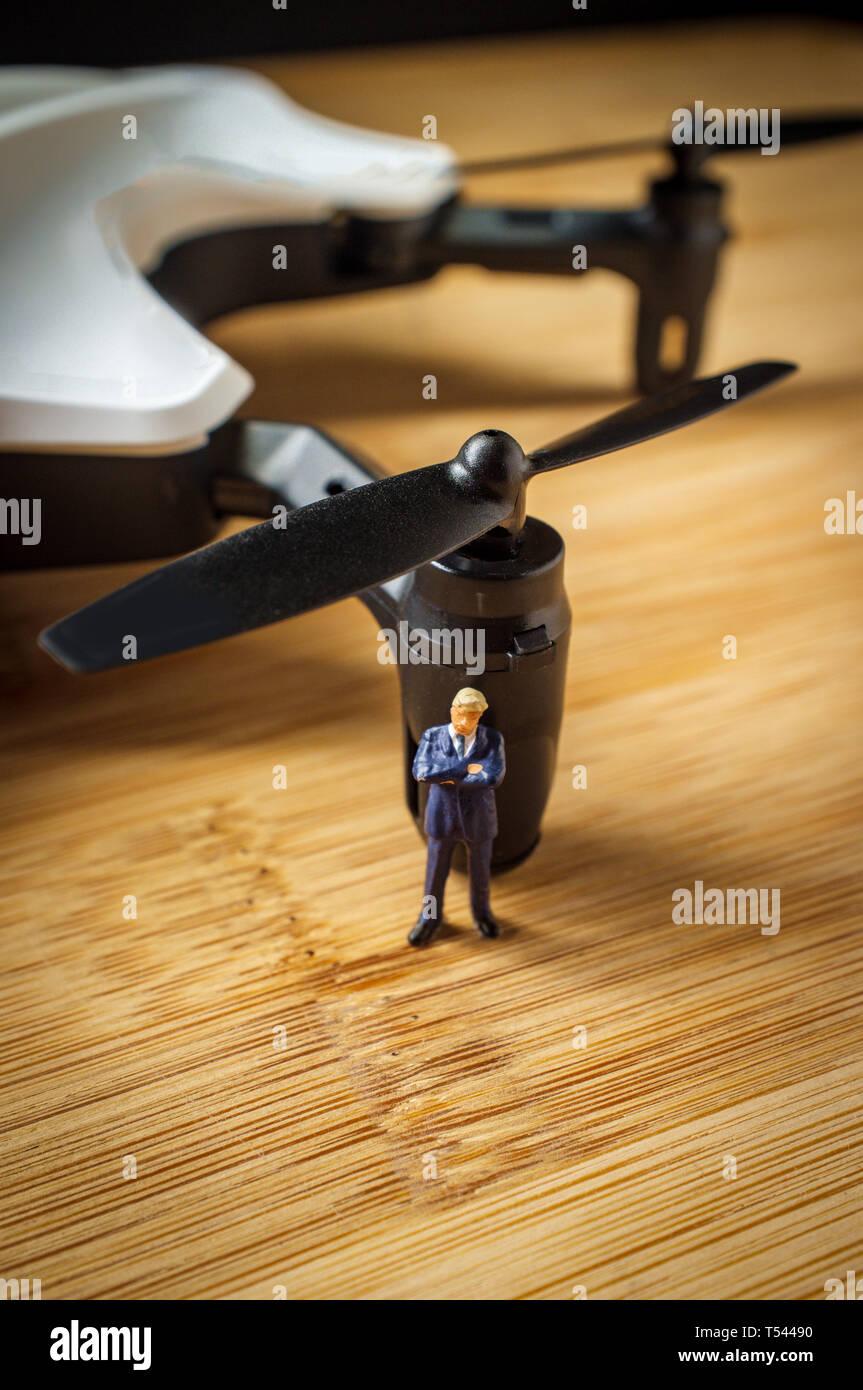 Closeup macro miniature businessmen figurines with drone
