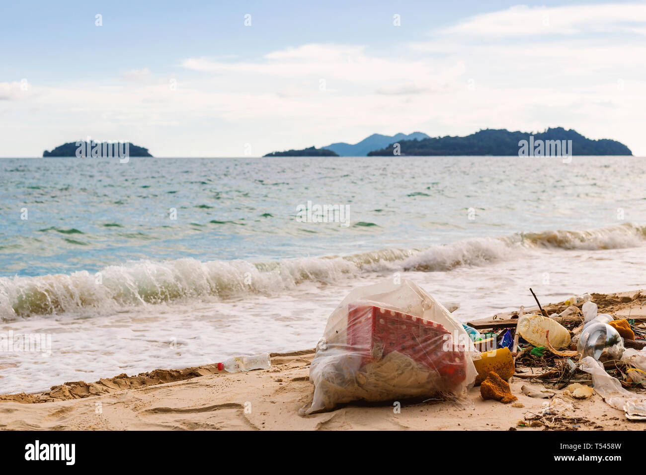 The destruction of nature by the hand of man. From household garbage being dumped into the sea. - Stock Image