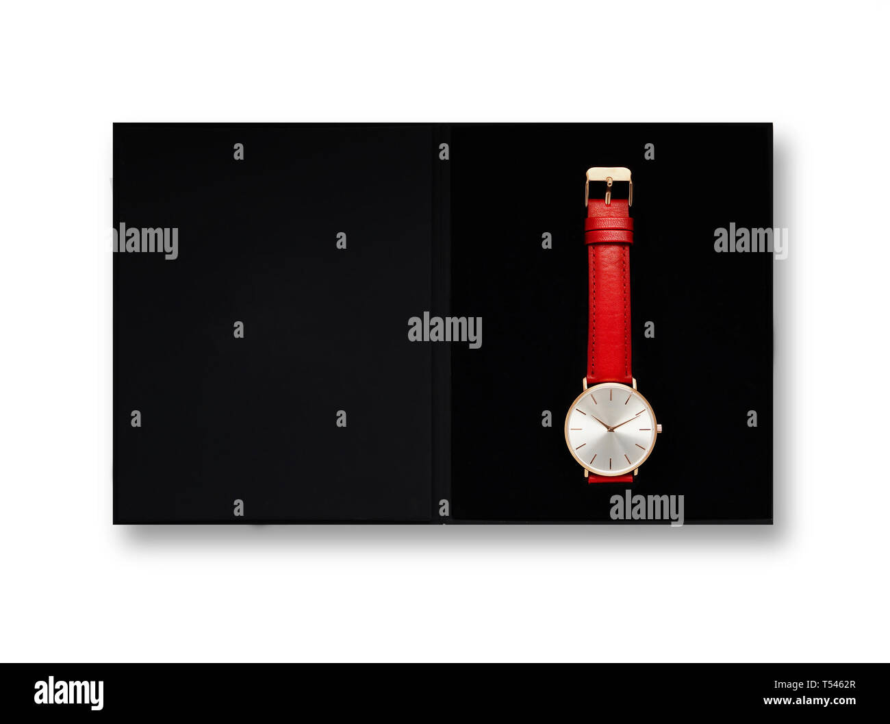 Classic women's gold watch with white dial, red leather strap, isolate on a white background. View from the top in the box. - Stock Image