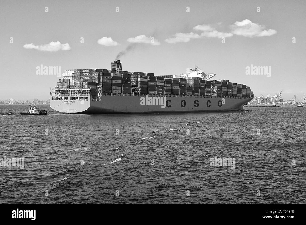 Black And White Image Of The Fully Loaded COSCO Shipping, Container Ship, COSCO FORTUNE, Entering The Port Of Long Beach, California, USA. - Stock Image