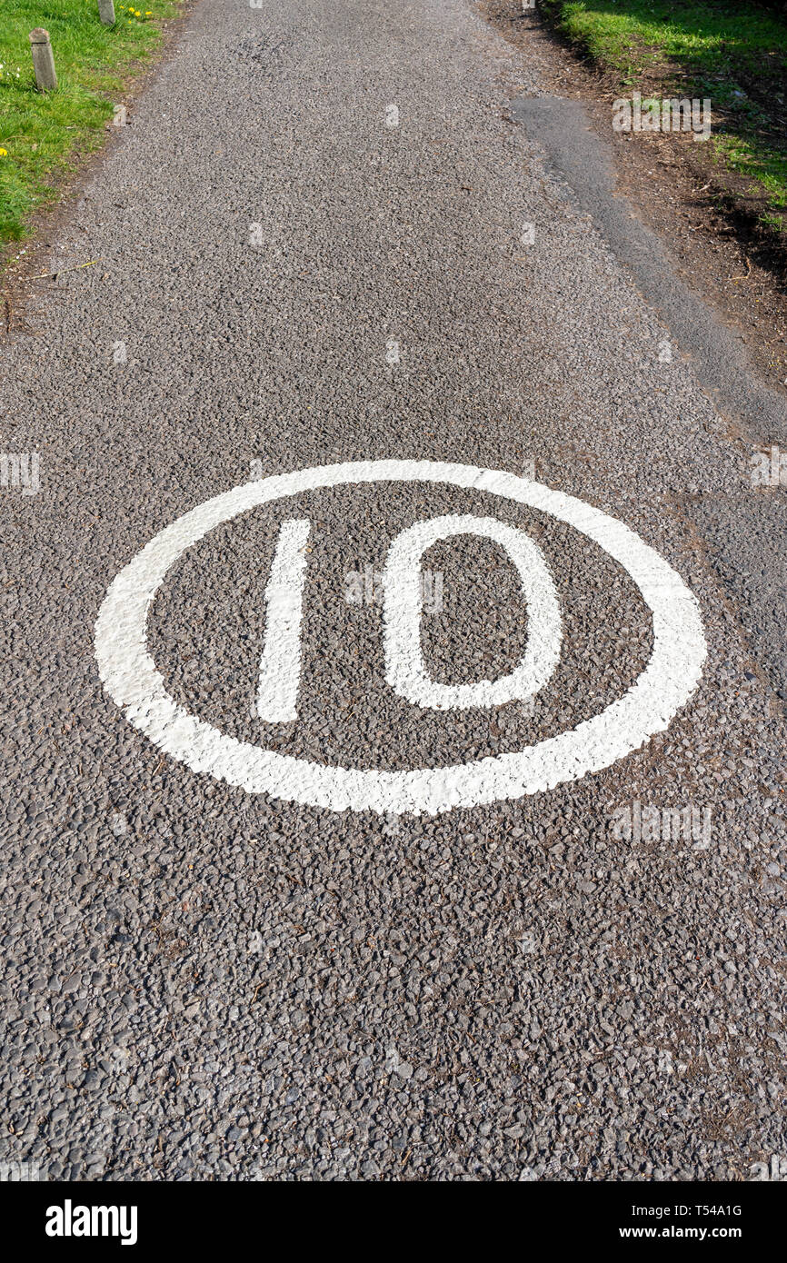 10 MPH speed limit sign painted on road surface Stock Photo