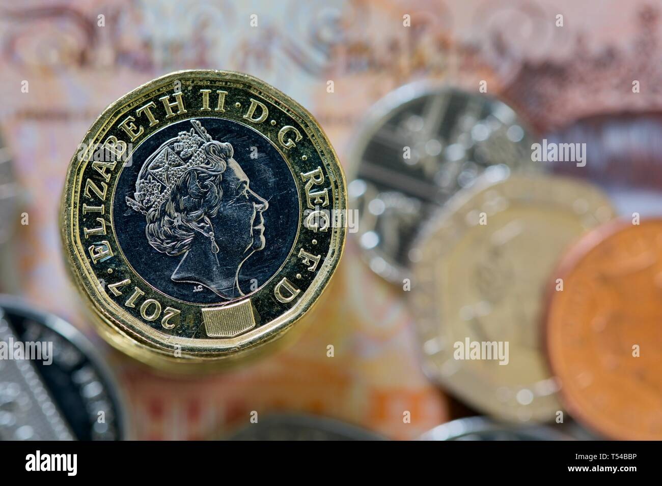 British currency, coins and banknote - Stock Image