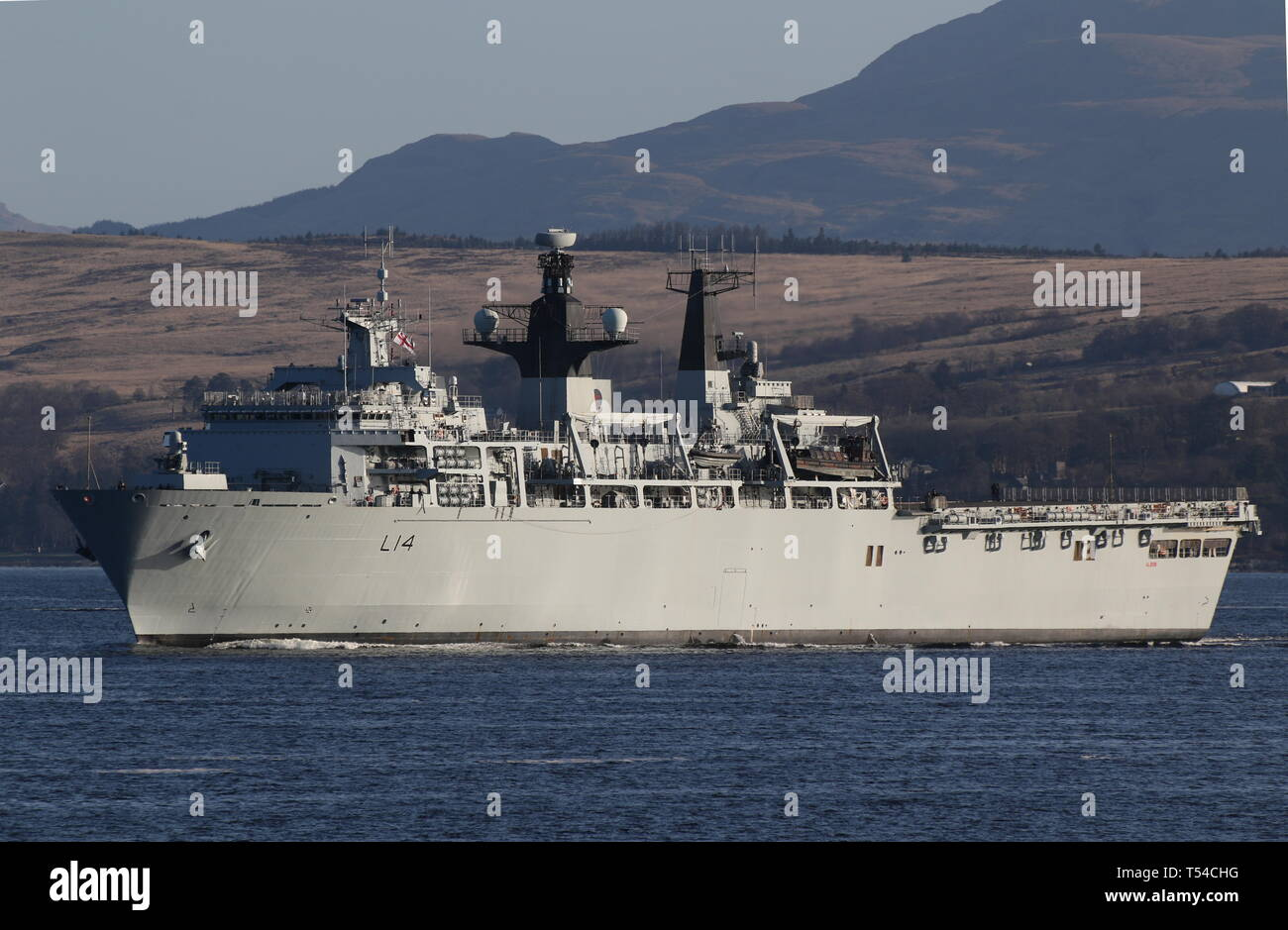 HMS Albion (L14), an Albion-class amphibious assault ship operated by the Royal Navy, passing Gourock at the start of Exercise Joint Warrior 19-1. Stock Photo
