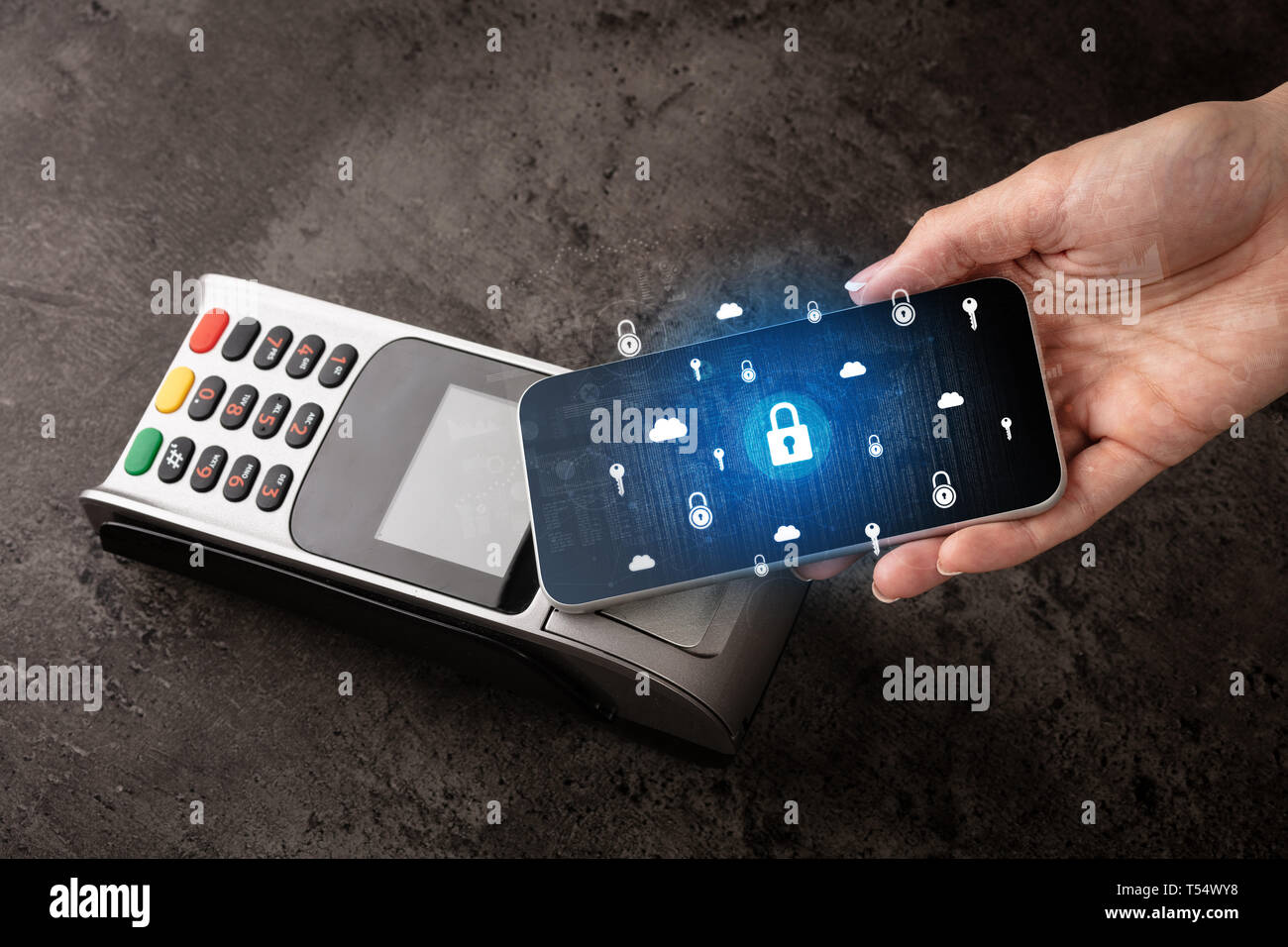 Hand paying with cellphone on POS, secure payment concept  - Stock Image
