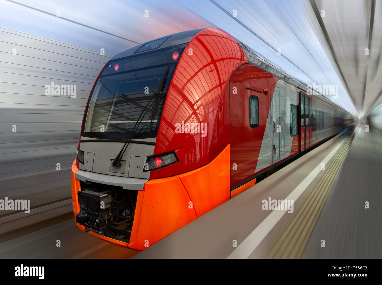 Fast train of Moscow Central Circle with motion blur - Stock Image