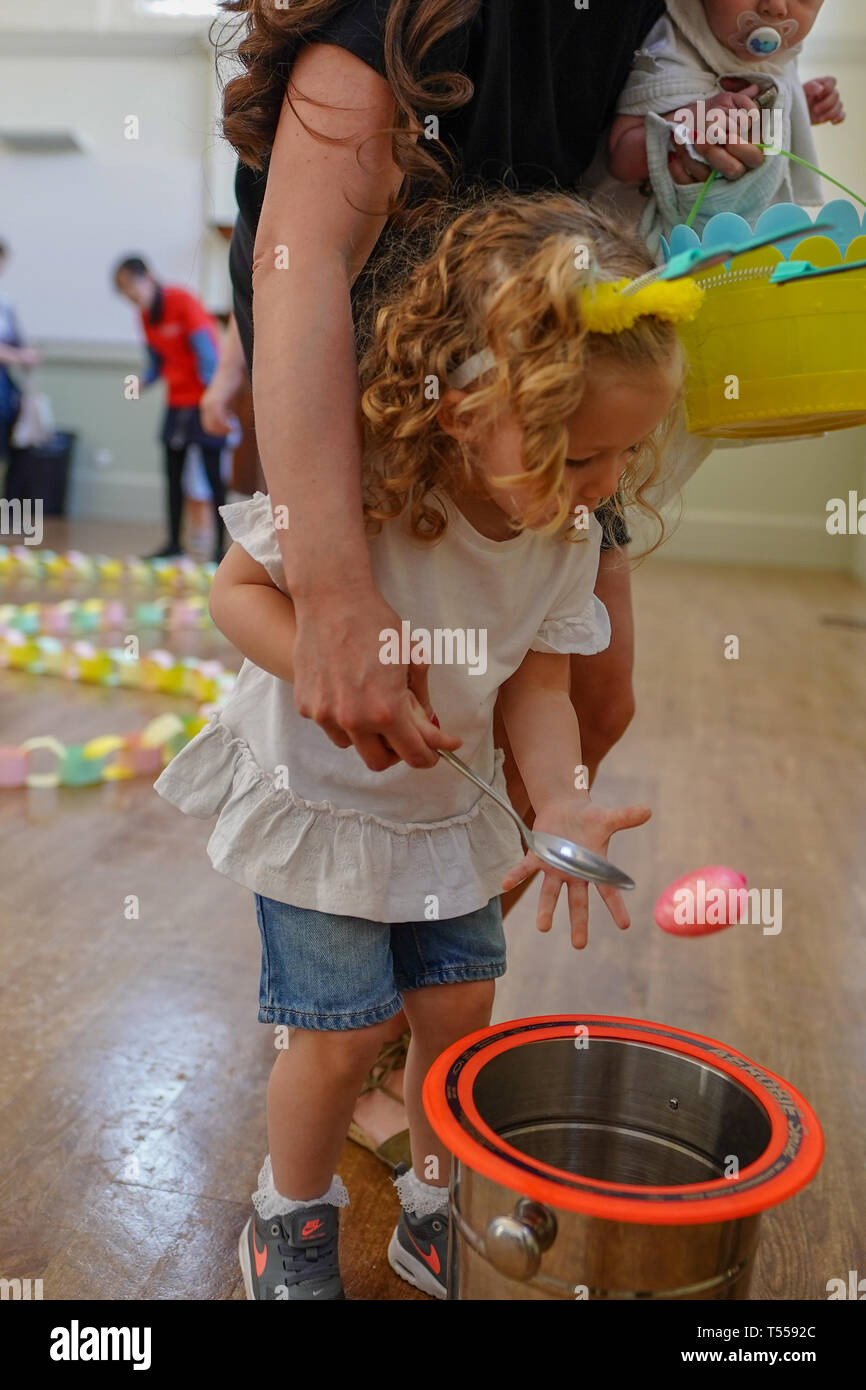 A child playing an egg and spoon game during an Easter egg hunt at Shoreditch Town Hall in London. Photo date: Saturday, April 20, 2019. Photo: Roger  - Stock Image