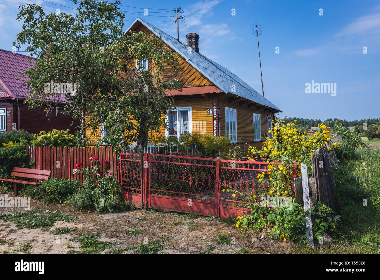 Houses in Soce village on so called The Land of Open Shutters trail, famous for traditional architecture in Podlaskie Voivodeship, Poland - Stock Image