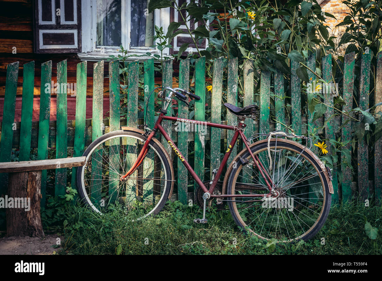 Bicycle in Soce village on so called The Land of Open Shutters trail, famous for traditional architecture in Podlaskie Voivodeship, Poland - Stock Image